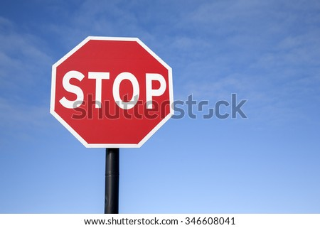 Red Stop Traffic Sign on Blue Sky Background