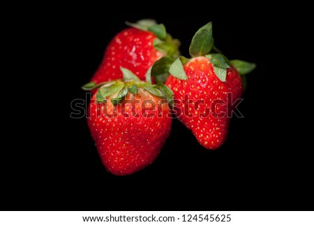 Red Strawberries on a Black Background - stock photo