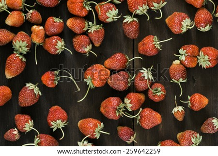 red strawberries on the wooden background - stock photo