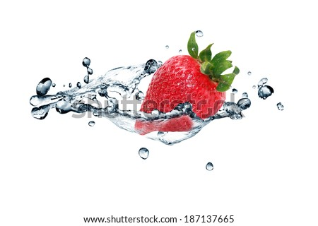 Red strawberry fruit in flowing water on white background