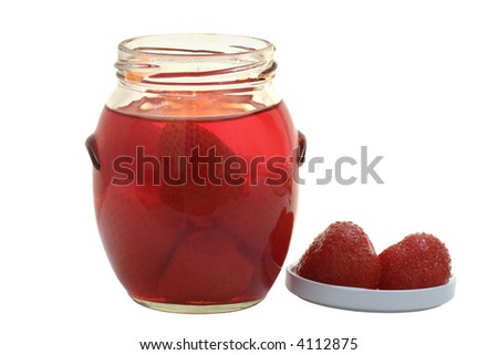 Red Strawberry Jam; Focus on two berries next to jar