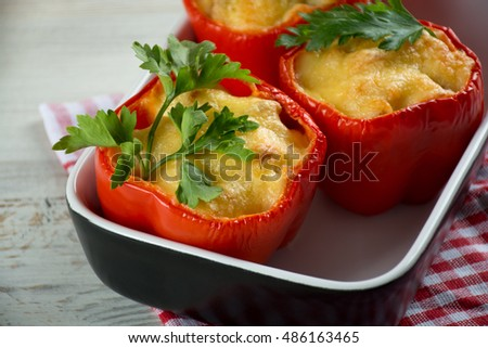 Red stuffed peppers with cheese, tomato, onion and mushroom