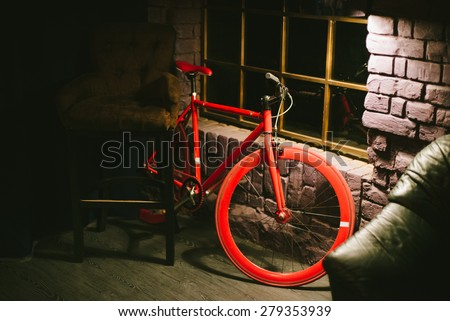 Red stylish bike hipster cafes in the evening. interior cafe - stock photo