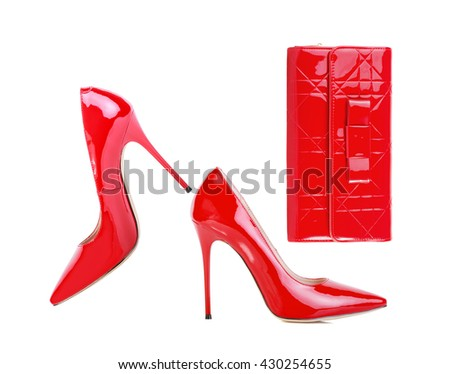 Red stylish high heels with clutch isolated on white background - stock photo