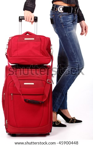 red suitcase and women's legs - stock photo