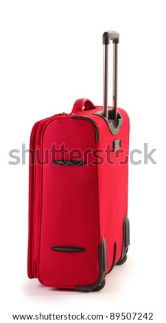 Red suitcase isolated on a white