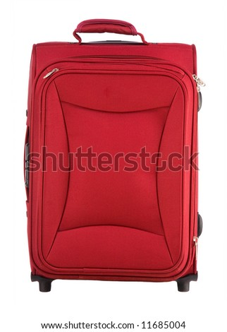 Red suitcase on castors close up on a white background - stock photo