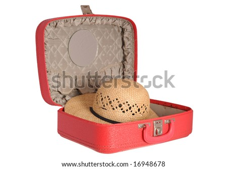 Red suitcase with a straw hat