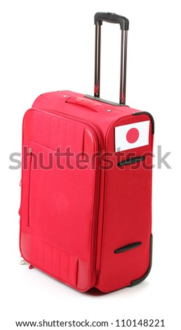 red suitcase with sticker with flag of Japan isolated on white