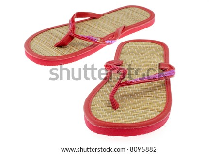 Red summer sandals on a white background.