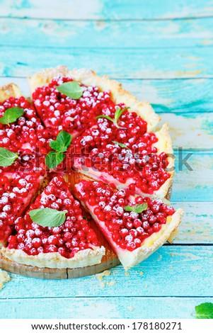 red summer tart with custard, food closeup - stock photo
