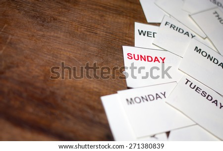 Red Sunday word with another date on wood table