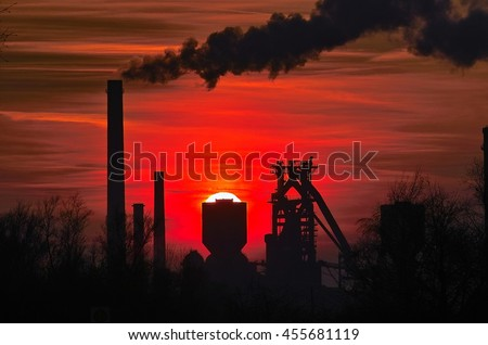 Red Sundown behind a Steel factory / Stahlwerke Bremen, Germany, Silhouette