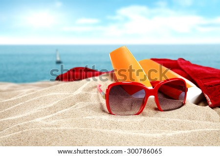 red sunglasses and red towel  - stock photo