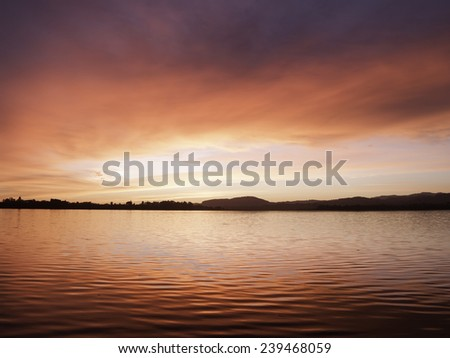 Red sunrise over Tauranga Harbor, New Zealand. - stock photo