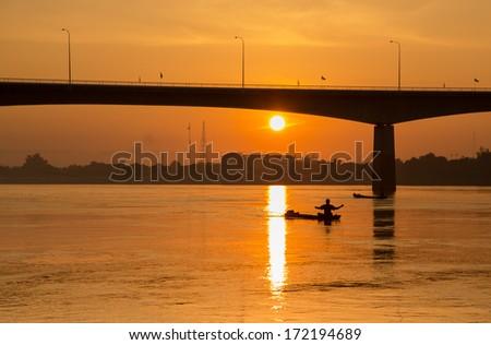 red sunset and bridge - stock photo