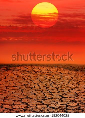 Red sunset in desert - stock photo
