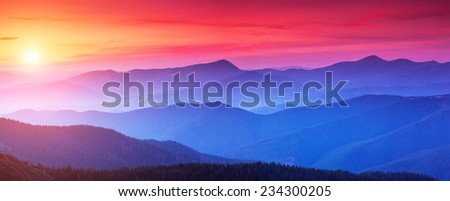 Red sunset in the mountains landscape with sunny beams. Dramatic scene. Carpathian, Ukraine, Europe. Beauty world. Retro style, vintage filter. Instagram toning effect. - stock photo