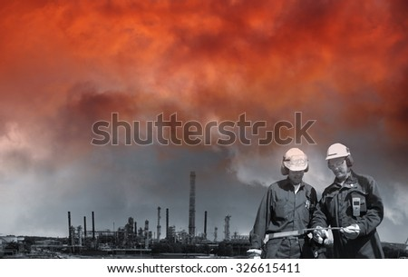 red sunset over chemical industry and refinery workers - stock photo