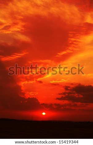 red sunset sky stormy clouds - stock photo