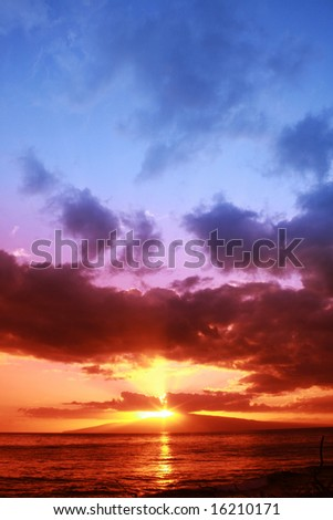 Red sunset (taken with graduated rose filter) over the island of Lanai - stock photo