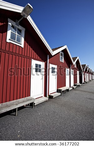 red swedish boat houses on a sunny day