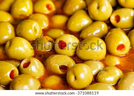 Red sweet pepper stuffed olives on a traditional craftsman market.Horizontal image.