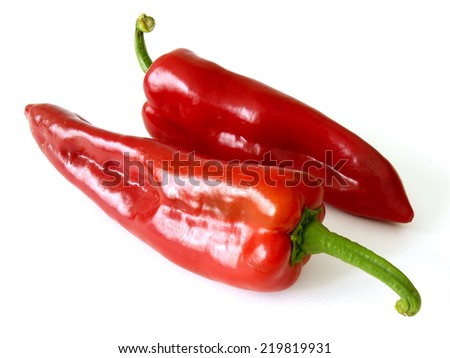 red sweet peppers on white - stock photo