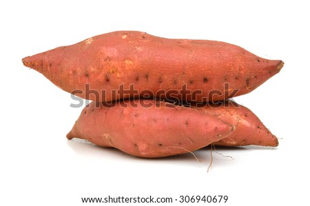 Red sweet potatoes on the white background. - stock photo