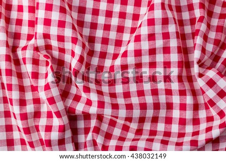 red tablecloth background,crumpled fabric background - stock photo