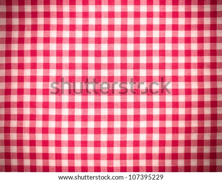 Red tablecloth background with vignette - stock photo