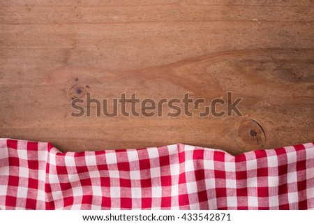 red tablecloth on wooden background, tablecloth with wooden background