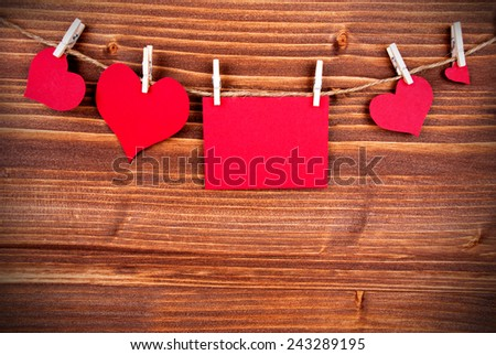 Red Tag Or Label With Four Hearts On A Line With Copy Space For Your Text Here On Wooden Background, Four Symbols, Vintage, Retro and Old Fashion Style With Frame - stock photo