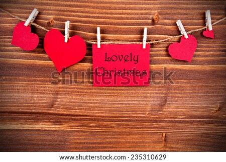 Red Tag Or Label With Four Hearts On A Line With Lovely Chirstmas On Wooden Background, Four Symbols, Vintage, Retro and Old Fashion Style With Frame - stock photo