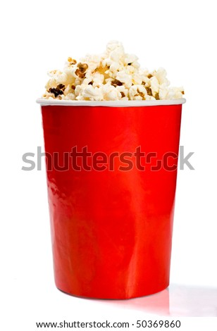 Red tall bowl with popcorn isolated on white