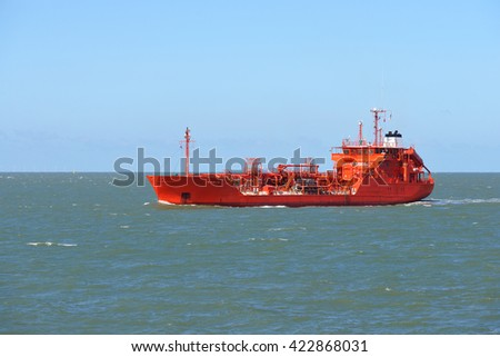 Red tanker cargo ship sailing to port in Vlissingen, the Netherlands