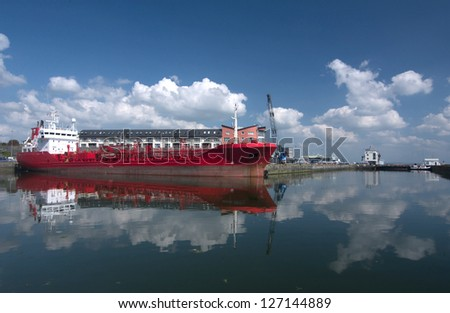 red tanker ship docked in galway bay