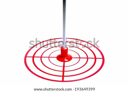 Red target and an arrow isolated on white background backdrop - stock photo