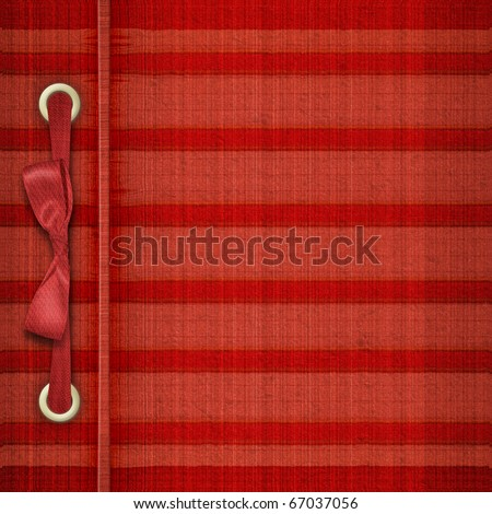 Red tartan cover for album with ribbons and bow - stock photo