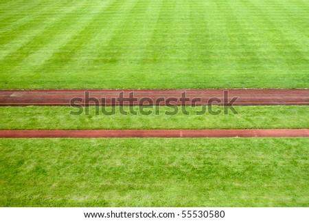 red tartan lines in sports stadium - stock photo