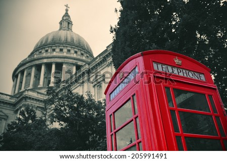 Red telephone booth and St Pauls Cathedral in London. - stock photo