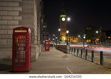 Red Telephone Booth at night and Big Ben, London, United Kingdom - stock photo