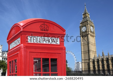 Red telephone booth, Big Ben clock tower, London UK - stock photo