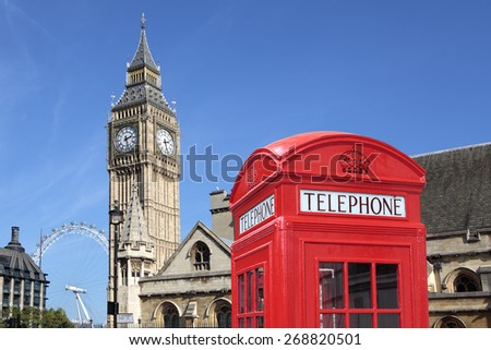 Red telephone booth, Big Ben clock tower, Parliament, London - stock photo