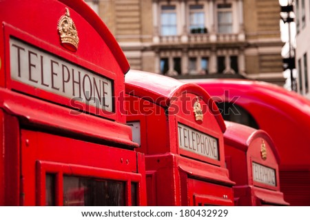 red telephone booths in london - stock photo