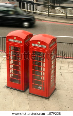 Red telephone box and black taxi in London, England - stock photo
