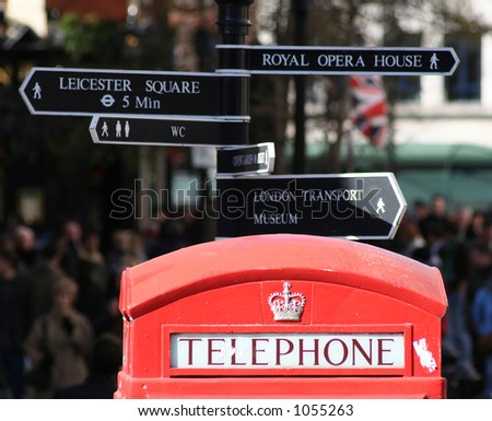 Red telephone box and London signpost - stock photo