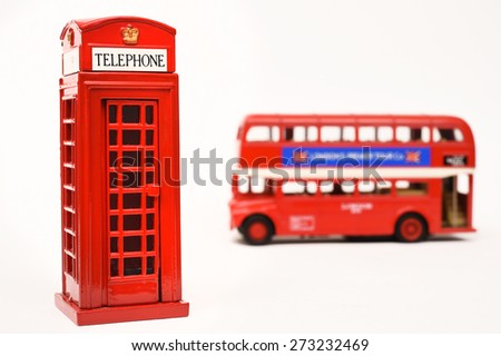 Red telephone box and red bus  - stock photo
