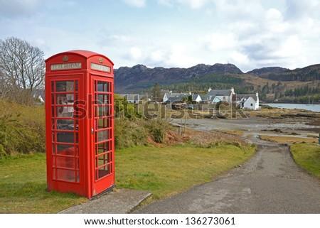 Red telephone box in Scotland - stock photo