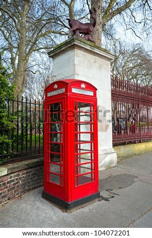 Red telephone box near kensington garden, london, Uk. - stock photo